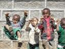 kids climbing on fence