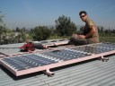 chris with solar panels