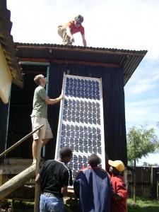 Kai Staats installing a solar PV array, Morokoshi School, rural Kenya, 2008