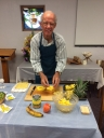 Dick Staats cutting pineapple